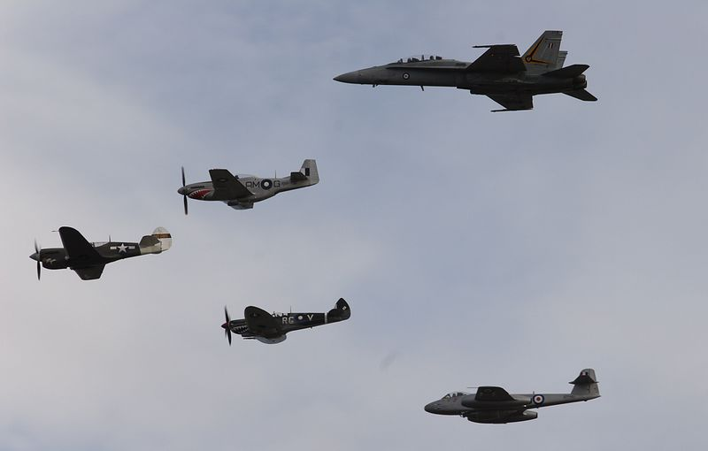 Col Paye's P-40 Kittyhawk leads a formation of RAAF Historical Flight Mustang, Temora Aviation Museum's Spitfire and Meteor shephered by RAAF Hornet F/A 18-B over Lake Burley Griffin in the finale flypast. This image was published in Aero Australia issue 8.