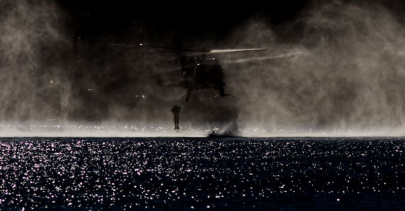 """Clearance diver extraction by Army """"Huey""""."""