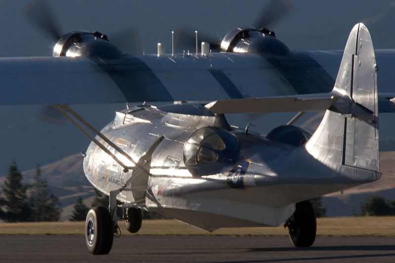 I love the effects of the late afternoon sun on the Cat's fueslage. Nosewheel just rotating.
