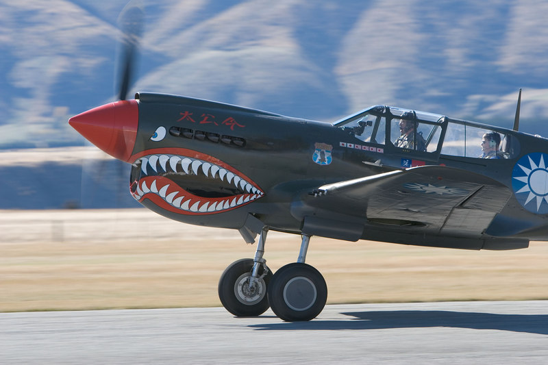 John Lanham and James Slade lift off from Wanaka in James' Curtis P-40E Warhawk.