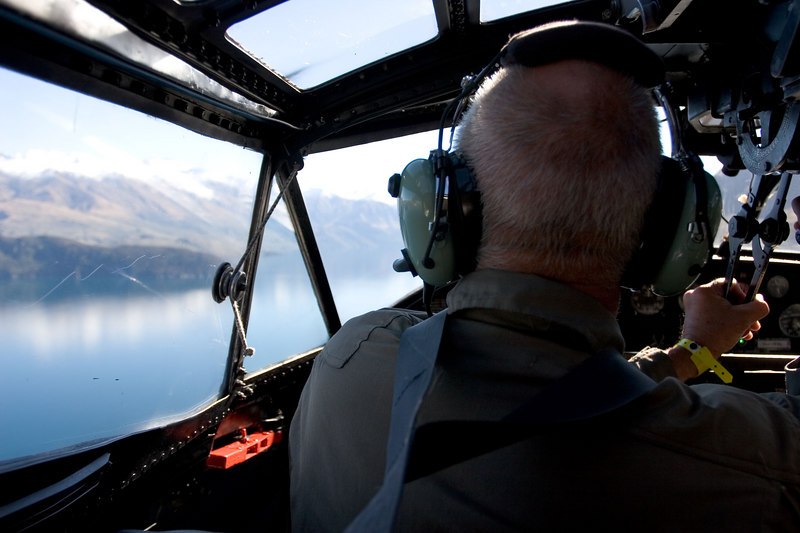 This was a great opportunity to fly in the old Cat. The water touch and go on Lake Wanaka was a unique buz. Interesting cross-handed technnique for the captain on the throttles! A Dakota(C-47) flew in formation with us and allowed its occupants to shoot images of the Cat on the water.