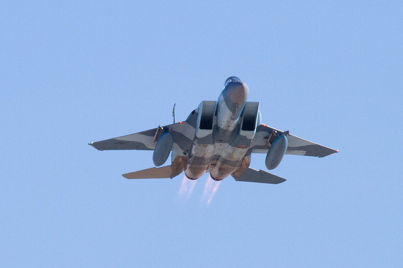 An F-15 with full afterburners taking off from Nellis AFB.