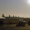 Date: unknown - Location: LIRP<br /> Dep/Arv/Enr: n/a - RW/Taxi/Ramp: unknown<br /> Manufacturer: Lockheed<br /> Model: C130E - Ser/BuNo: unknown<br /> Unit:  37 TAS/435 TAW<br /> Misc: This photo was taken circa the early 1980s at the Pisa-San Giusto Airport, Italy. The 37 Tactical Airlift Squadron deployed aircraft to train on airdrop operations. Squadron C-130Es sit on the ramp ready for another day of flight operations