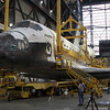 CAPE CANAVERAL, Fla. -- In the Vehicle Assembly Building at NASA's Kennedy Space Center in Florida, workers attach an overhead crane to shuttle Atlantis. The crane will lift the spacecraft into a high bay where it will be attached to the waiting external fuel tank and solid rocket boosters already on the mobile launcher platform. Commander Chris Ferguson, Pilot Doug Hurley and Mission Specialists Sandra Magnus and Rex Walheim are expected to launch mid July, taking with them the Raffaello multi-purpose logistics module packed with supplies, logistics and spare parts.