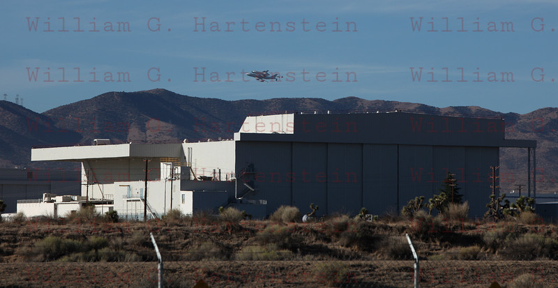 NASA905/Endeavour does a flyby over Site 2 at Palmdale Airport Palmdale, CA Sept. 21, 2011