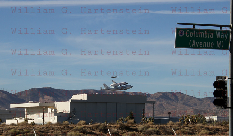 NASA905/Endeavour does a flyby over Site 2 where the Space Shuttle was built. Palmdale Airport, CA Sept. 21, 2011