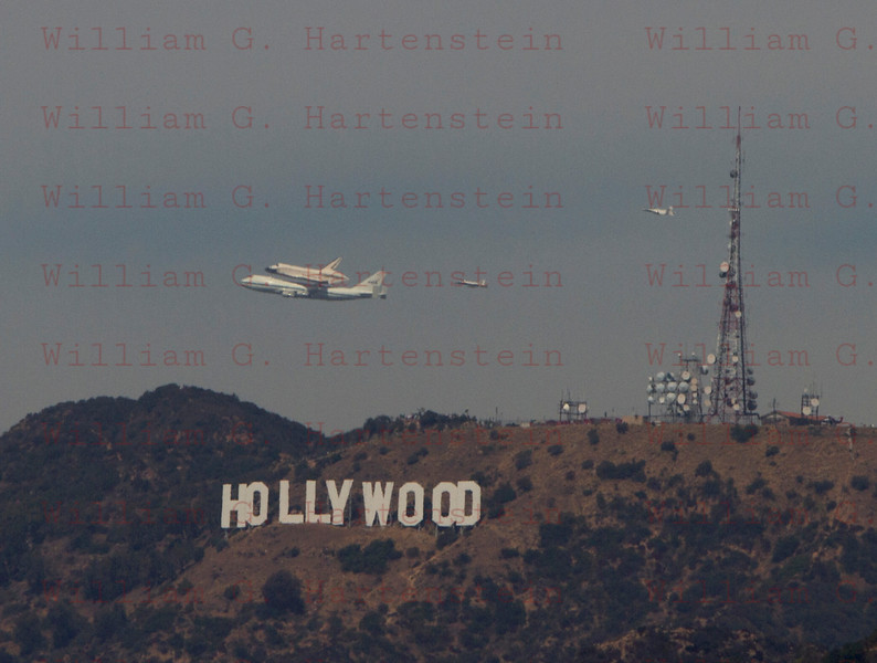 NASA905/Endeavour does a flyby over Hollywood Sign in Los Angeles, CA Sept. 21, 2011