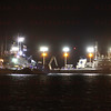 CAPE CANAVERAL, Fla. -- The solid rocket booster retrieval ships Freedom Star and Liberty Star tow the two spent booster to the dock overnite at Port Canaveral in Florida. The booster was used during space shuttle Endeavour's final launch. The shuttle's two solid rocket booster casings and associated flight hardware are recovered in the Atlantic Ocean after every launch by Freedom  Star and Liberty Star. The boosters impact the Atlantic about seven minutes after liftoff and the retrieval ships are stationed about 10 miles from the impact area at the time of splashdown. After the spent segments are processed, they will be transported to Utah, where they will be refurbished and stored, if needed.