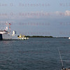 CAPE CANAVERAL, Fla. -- The solid rocket booster retrieval ship Freedom Star tows a left spent booster to the dock at Hangar AF on Cape Canaveral Air Force Station in Florida. The booster was used during space shuttle Endeavour's final launch. The shuttle's two solid rocket booster casings and associated flight hardware are recovered in the Atlantic Ocean after every launch by Freedom  Star and Liberty Star. The boosters impact the Atlantic about seven minutes after liftoff and the retrieval ships are stationed about 10 miles from the impact area at the time of splashdown. After the spent segments are processed, they will be transported to Utah, where they will be refurbished and stored, if needed.