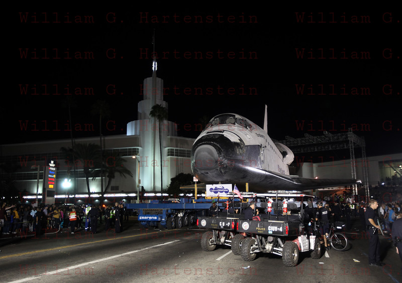 OV-105 Endeavour on Martin Luther King Blvd, arrives at the Baldwin Hills Crenshaw Plaza, CA. Oct. 13, 2012
