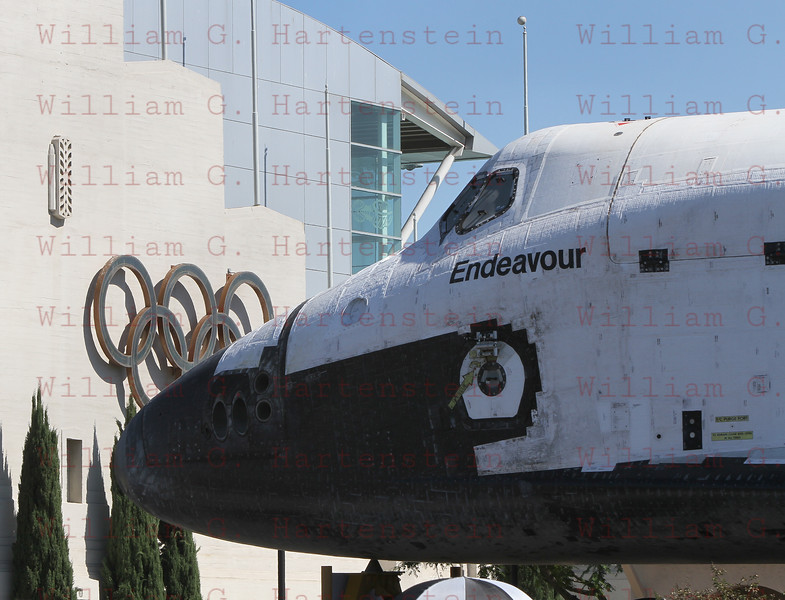 OV-105 Endeavour on Bill Robertson Lane and approaches the Loa Angeles Swimming Stadium. Oct. 14, 2012 The Los Angeles Swim Stadium was built for the 1932 Olympics.