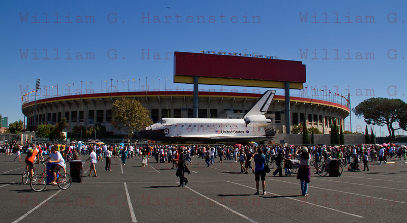 OV-105 Endeavour on Bill Robertson Lane and passes the Los Angeles Coliseum. Oct. 14, 2012 The Coliseum was built im 1921 and hosted two Olympics.