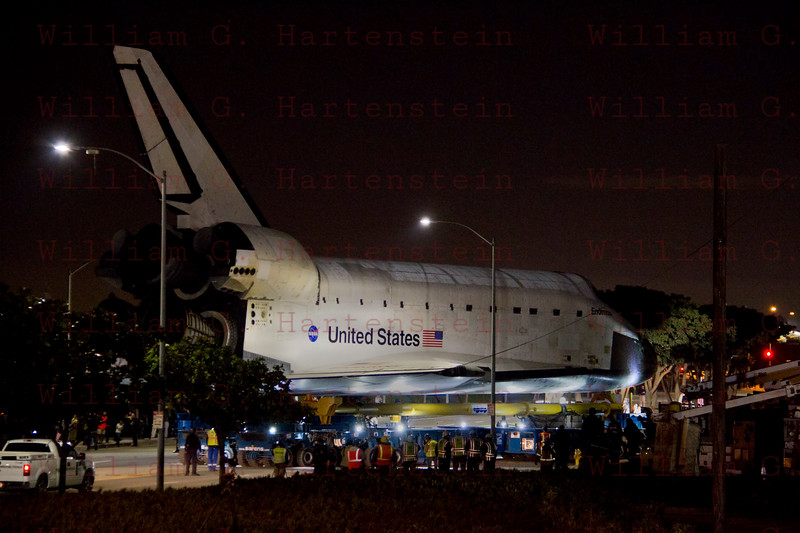 OV-105 Endeavour departs LAX heads up Westchester Parkway at McConnell Ave. Oct. 12, 2012