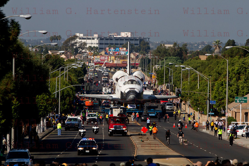 OV-105 Endeavour leaves Forum and heads up Manchester Blvd in Inglewood, CA. Oct. 13, 2012