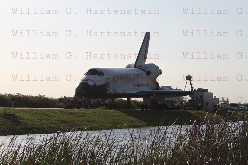 One last time, the shuttle Discovery dropped out of orbit and returned to Earth Wednesday to wrap up a near-flawless 39th and final mission, a milestone marking the beginning of the end for NASA's winged rocketships and touchdown on runway 15 at 11:57:17 a.m. EST (GMT-5).