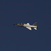 A NASA T-38 flys over, the shuttle Discovery after it returned to Earth Wednesday to wrap up a near-flawless 39th and final mission, a milestone marking the beginning of the end for NASA's winged rocketships and touchdown on runway 15 at 11:57:17 a.m. EST.