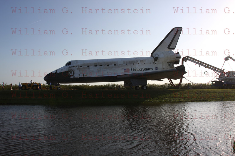One last time, the shuttle Discovery dropped out of orbit and returned to Earth Wednesday to wrap up a near-flawless 39th and final mission, a milestone marking the beginning of the end for NASA's winged rocketships and touchdown on runway 15 at 11:57:17 a.m. EST