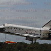 KENNEDY SPACE CENTER, FL--Enduring the heat of re-entry one last time, the shuttle Discovery dropped out of orbit and returned to Earth Wednesday to wrap up a near-flawless 39th and final mission, a milestone marking the beginning of the end for NASA's winged rocketships.<br /> <br /> After firing its twin braking rockets for a computer-controlled descent halfway around the planet, commander Steven Lindsey took over manual control and guided Discovery through a 250-degree left turn to line up on runway 15.<br /> <br /> Pilot Eric Boe then deployed the ship's landing gear and the 204,000-pound shuttle swooped to a tire-smoking touchdown on runway 15 at 11:57:17 a.m. EST (GMT-5).<br /> <br /> Lindsey had no problems with a stiff 25-knot headwind and a few moments later, NASA's oldest surviving space shuttle rolled to a halt, wrapping up a career spanning some 5,750 orbits, 148 million miles and 365 days in space during 39 missions since its maiden launch in August 1984.