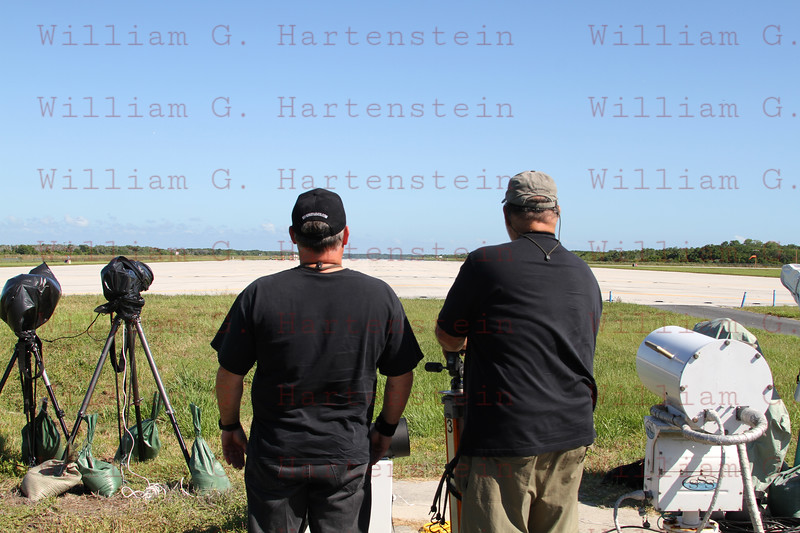 Photographers marvel at the Shuttle Landing Runway during setup remote cameras to capture the STS-134 Landing