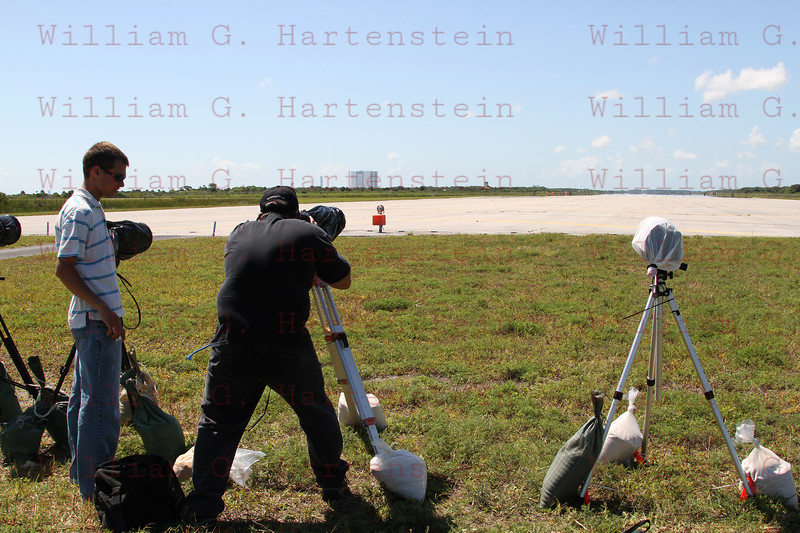 Photographers setup remote cameras to capture the STS-134 Landing