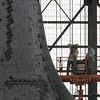 STS-134 Endeavour during lift in VAB  Mar. 1, 2011. Technicians start photo survey of leading edge of Endeavours wings.