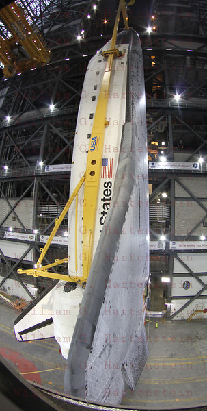 STS-134 Endeavour during lift in VAB  Mar. 1, 2011.