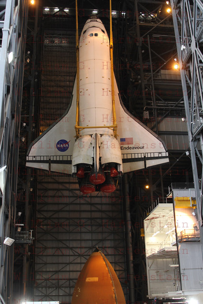 STS-134 Endeavour being lowered to her ET/SRB's during lift in VAB  Mar. 1, 2011.