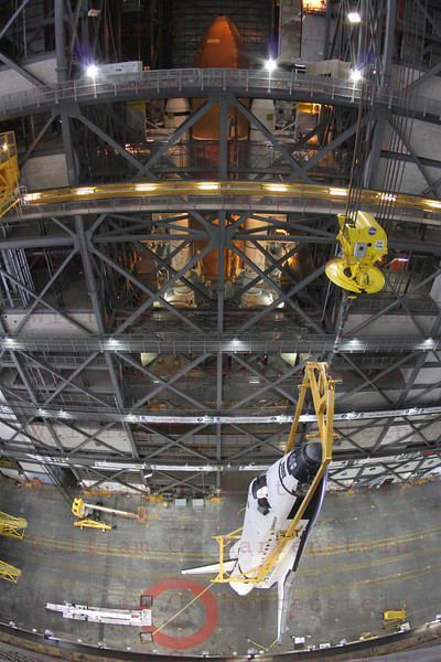 STS-134 Endeavour with ET/SRBs in background during lift in VAB  Mar. 1, 2011.