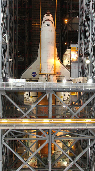 STS-134 Endeavour lowered down to ET/SRB's during lift in VAB  Mar. 1, 2011.