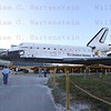 STS-134 moves from OPF-2 to VAB for the final time Feb. 28, 2011 while Pilot Greg Johnson and MS Roberto Vittori walk over to greet the media.