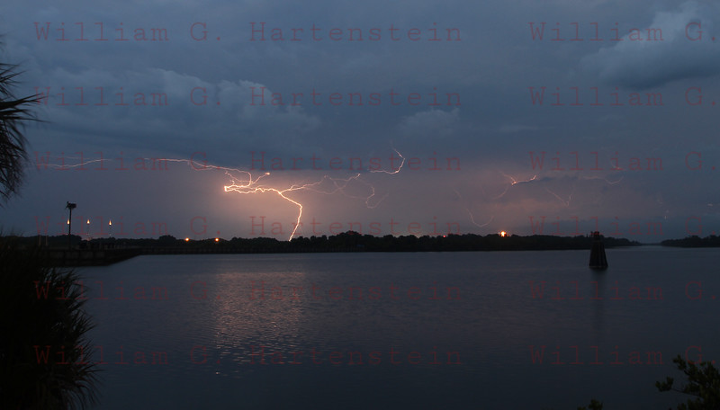 STS-134 Lightning hits between Pads 39B and 39A while an Ospery sits on its nest.April 28, 2011