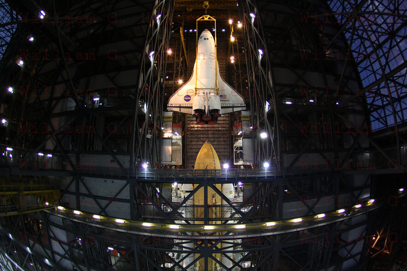 CAPE CANAVERAL, Fla. -- In the Vehicle Assembly Building at NASA's Kennedy Space Center in Florida, shuttle Atlantis is lifted by an overhead crane and moved into a high bay where it will be attached to its external fuel tank and solid rocket boosters which are already on the mobile launcher platform. Commander Chris Ferguson, Pilot Doug Hurley and Mission Specialists Sandra Magnus and Rex Walheim are expected to launch in mid-July, taking with them the Raffaello multi-purpose logistics module packed with supplies, logistics and spare parts.