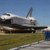 STS-135 Crew poses with Atlantis during roll out from OPF to VAB for the last time May 17, 201