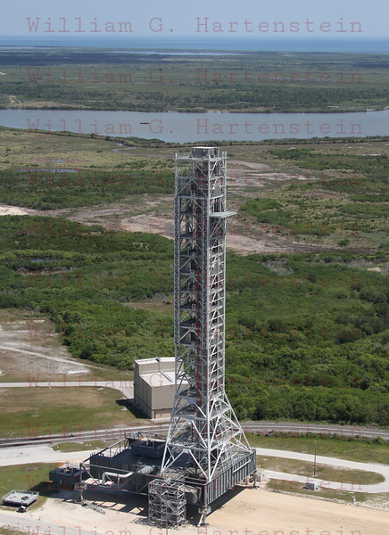 CAPE CANAVERAL, Fla. -- At NASA's Kennedy Space Center in Florida, NASA's new mobile launcher, or ML, support structure, consisting of a base, a tower and a launch mount, is complete. It took about two years to construct the launcher in the Mobile Launcher Park site, north of the Vehicle Assembly Building, or VAB. The 355-foot-tall structure will support NASA's future human spaceflight program. The base of the launcher is lighter than space shuttle mobile launcher platforms so the crawler-transporter can pick up the heavier load of the tower and a taller rocket.