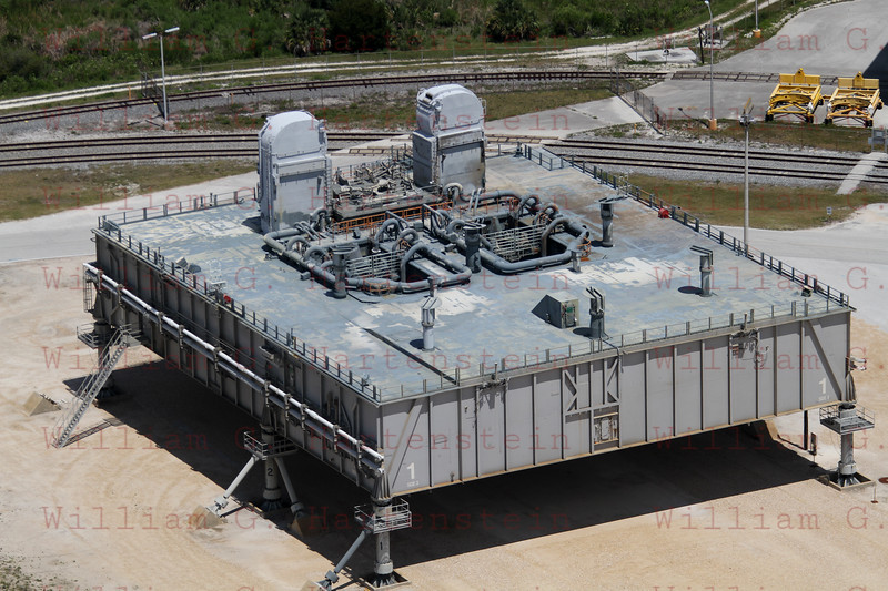 An aerial view of a mobile launcher platform that is parked in the Launch Complex 39 Area at NASA's Kennedy Space Center in Florida. The platform, which is a moveable base for the launch of space shuttle, is a two-story steel structure 25 feet high, 160 feet long and 135 feet wide. It is constructed of welded steel up to 6 inches thick. The platform rests on six 22-foot-tall pedestals.