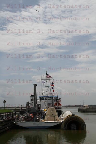 Liberty Star tows STS-135 right SRB thru Port Canaveral, Fl. Locks July 10, 2011