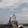 Liberty Star tows STS-135 right SRB thru Port Canaveral, Fl. Locks July 10, 2011