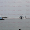 Liberty Star tows STS-135 right SRB thru Port Canaveral, Fl. July 10, 2011