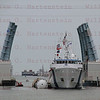Liberty Star tows back right STS-135 SRB thru Port Canaveral, July 10, 2011