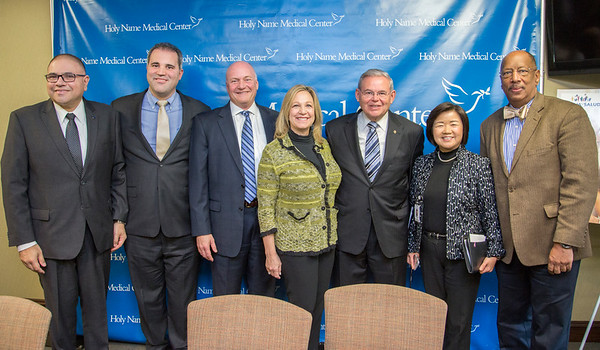 Left to Right: Dennis Gonzalez  Executive Officer  U.S. Department of Health and Human Services; Alexander Hesquijarosa, MD Internal Medicine Physician, Champion of Holy Name Medical Center's Familia y Salud; Michael Maron, President & CEO, Holy Name Medical Center; Assemblywoman Valerie Huttle (D); Bob Menendez, United States Senator;  New Jersey, Kyung Hee Choi, Asian Health Services, Holy Name Medical Center; Assemblyman Gordon M. Johnson (D)<br /> <br /> <br /> Affordable Care Act Latino Enrollment Initiative scaled up in Bergen County in final weeks before enrollment closes - Senator Bob Menendez, US Health and Human Services Executive Officer Dennis Gonzalez join Holy Name Medical Center to highlight enrollment initiatives.  Photo by Victoria Matthews/Holy Name Medical Center