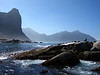 Duiker Island and Hout Bay are surrounded by the mountains of Chapmans Peak.