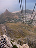 The Lower Cable Station begins to disappear as I zoom up the cliff in the cable car. In the distance you can see Lion's Head on the left, Signal hill, and western Cape Town.