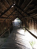The covered wooden pathways to the huts.