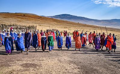 Maasai men and women dance