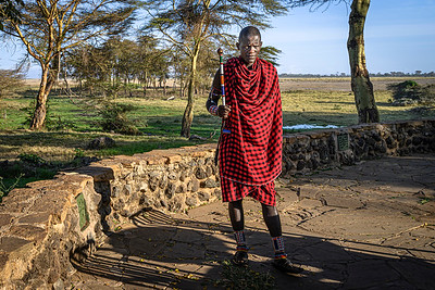 Maasai warrior holds a ceremonial scepter