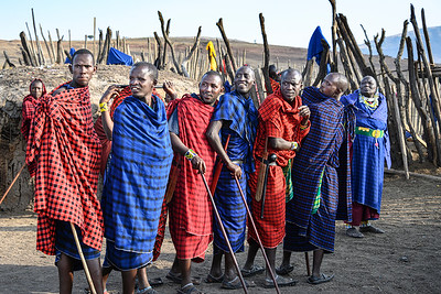 Maasai warriors share a moment