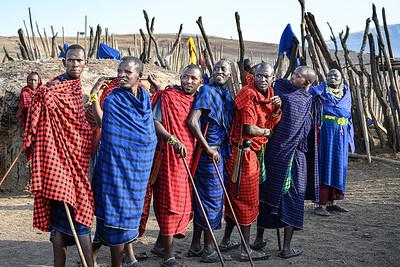 Maasai warriors share a moment
