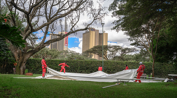 Putting up a tent in downtwon Nairobi, Kenya
