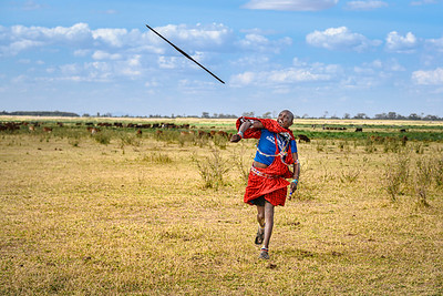 Maasai warrior hurls a spear