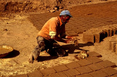 Making mud and straw bricks